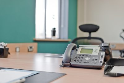 close up of desk phone at manchester east serviced office